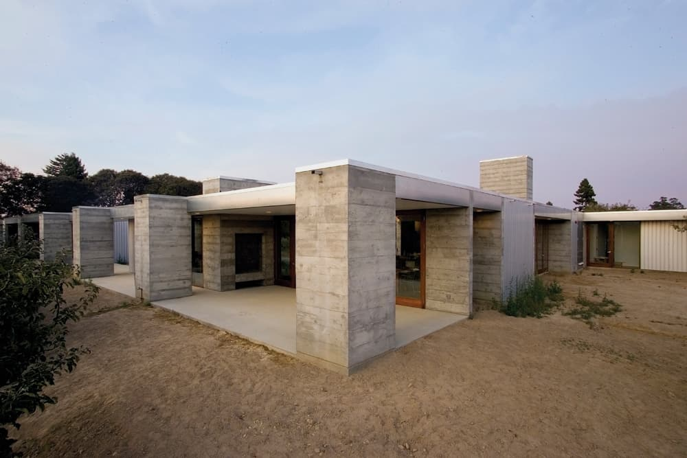 featured posts image for Concrete and glass farmhouse nestled in an orchard