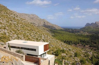 Modern dwelling surrounded by mountains in Pollença