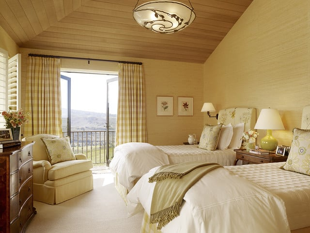 Hilltop retreat reflecting mediterranean elegance Master bedroom with yellow walls