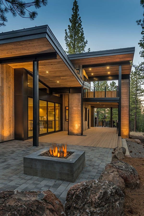 Mountain retreat blends rustic modern styling in martis camp for Modern rustic house plans
