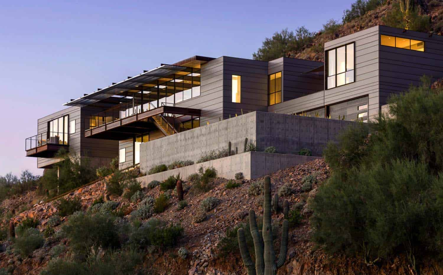 Concrete glass and steel structure hovers above arizona for Modern house design on hillside