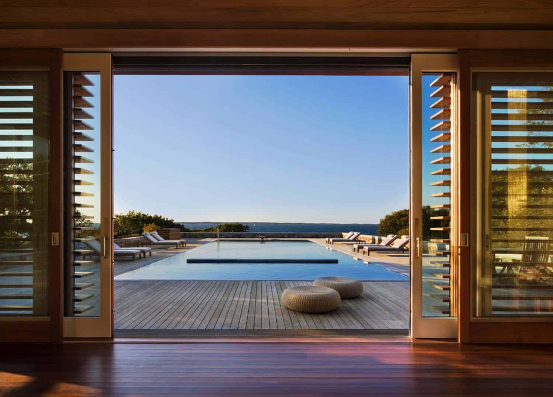 glass-sliding-doors-beach-style-poolhouse