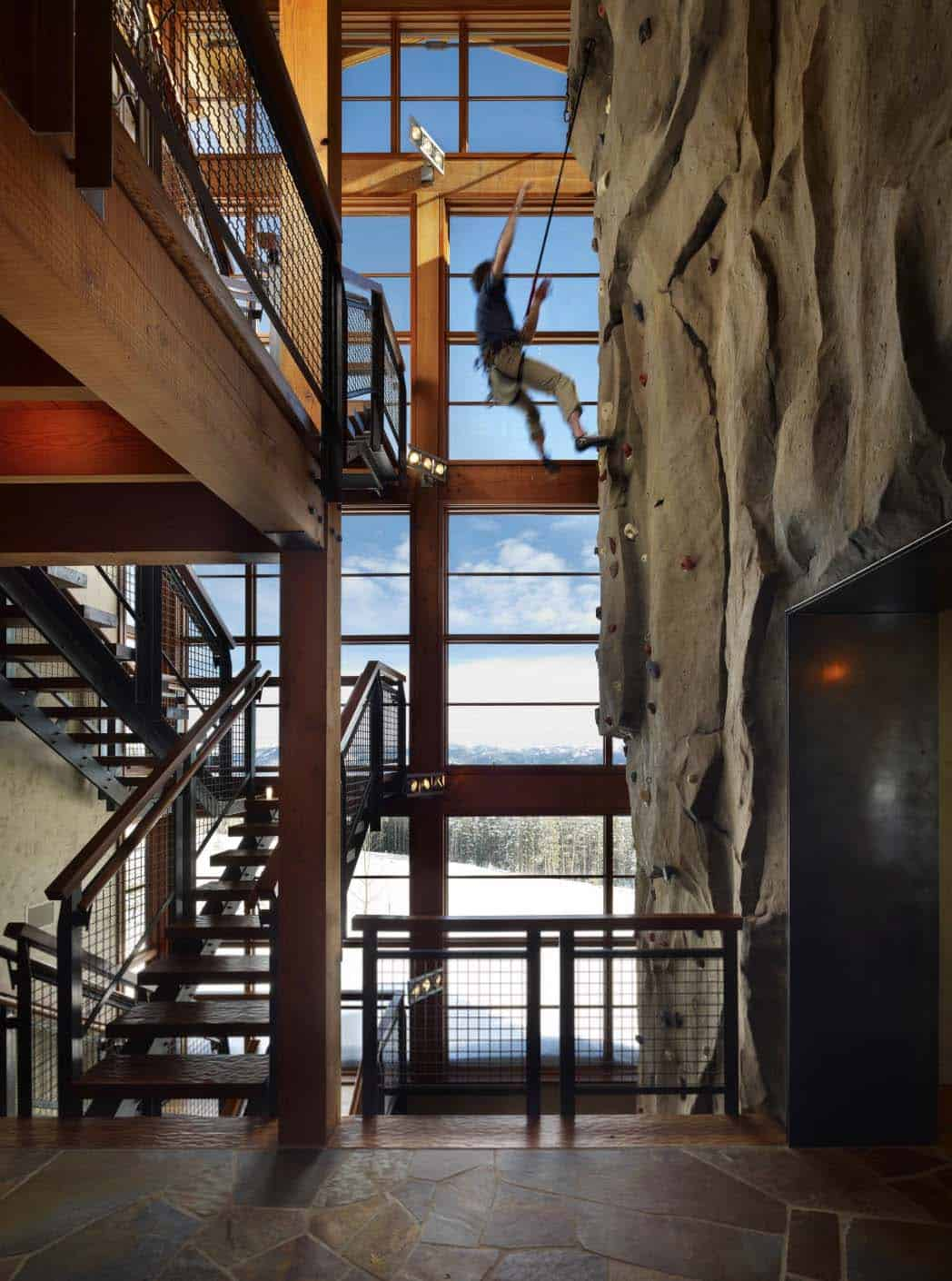 climbing-wall-in-action-at-stair-tower-industrial-staircase