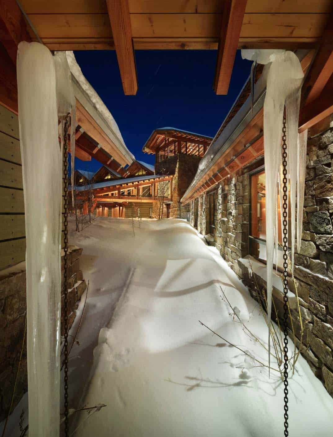 winter-view-back-to-entry-stair-tower-rustic-exterior