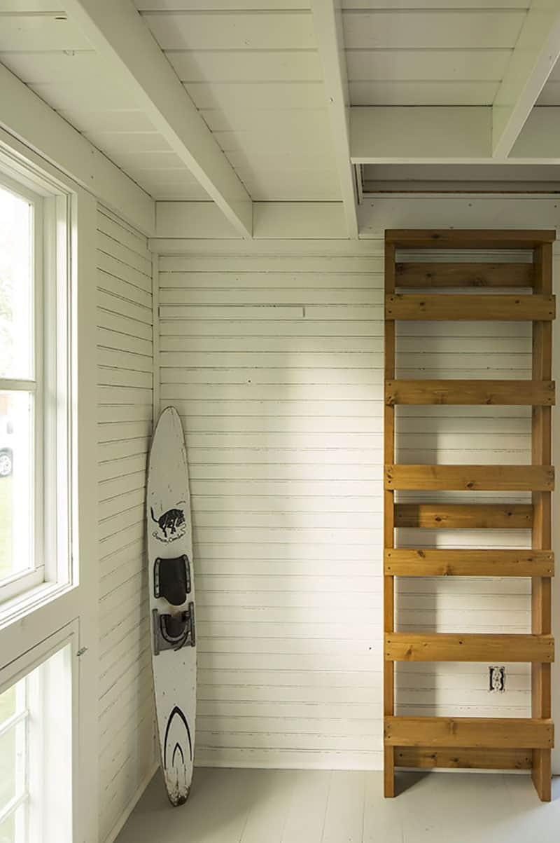 summer-lakeside-cottage-living-room-ladder-sleeping-loft