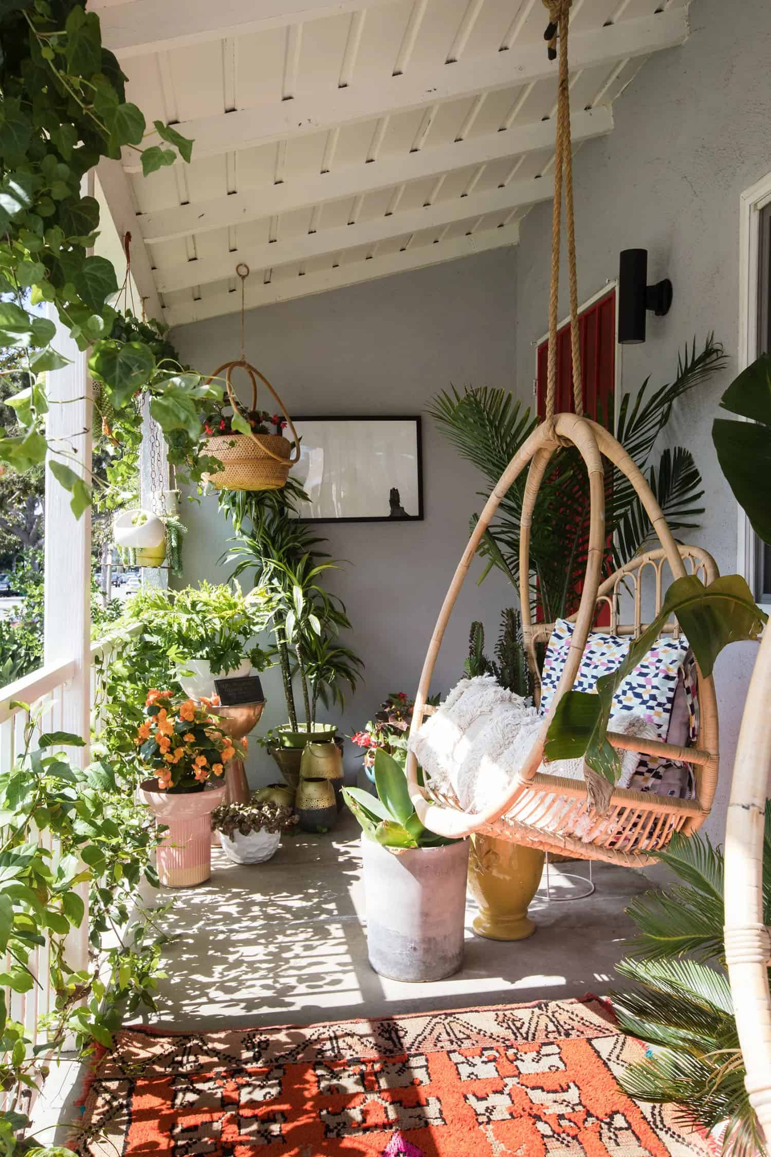 cozy-porch-with-a-hanging-swing-and-plants