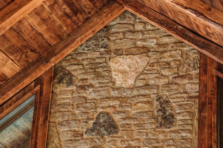 arkansas-stone-wall-detail-rustic-living-room